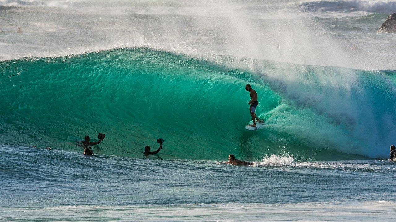 barreled surfer